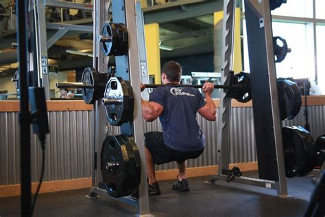 smith machine bench squat 4 exercises personal trainers often use and why they