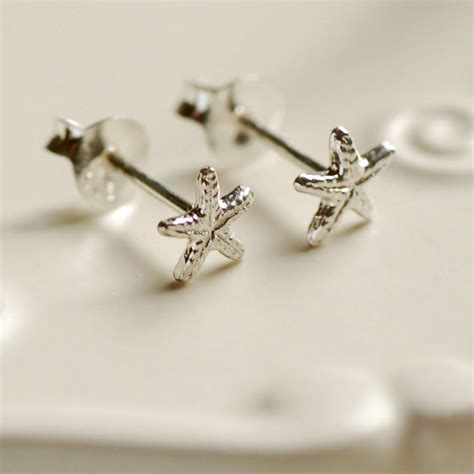 tiny silver starfish stud earrings by highland