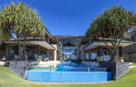 L Shaped House With Garage mermaid beachfront home set on almost 3 000 square metres