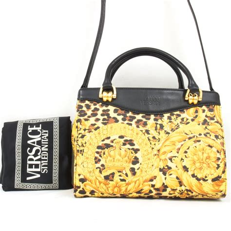 With Versace Purse by Vintage Gianni Versace Leopard Medusa Handbag With