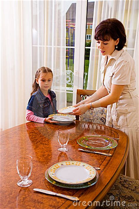 setting the table daughter and mom setting the table stock photos image