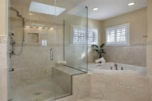 Modern master bathroom with large glass framed shower and a tiled edge