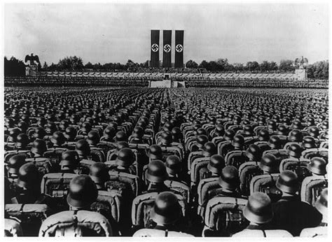 Hitler Nuremberg Nazi Rallies | hitler rally seen from behind rows of nazi soldiers