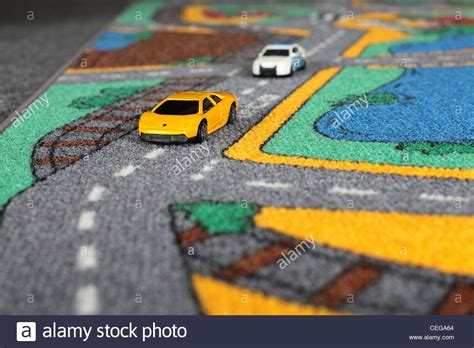 Toy Cars On A Rug Police Car Chasing A Lamborghini Stock Car Rug For