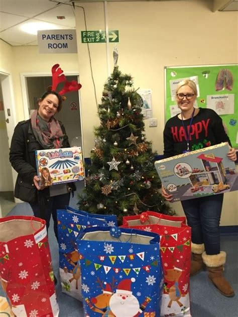 action for sick children delivers christmas gifts for