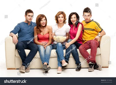 people on the couch friends sitting on couch watching tv stock photo 79776904