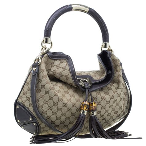 Gucci Rust Indy Large Top Handle Bag by Gucci Beige Monogram Canvas Large Indy Top Handle Bag