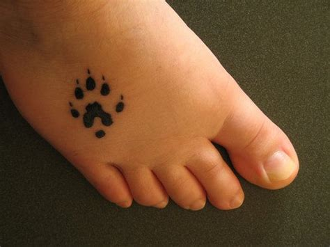 small bear paw tattoo on foot tattooshunt com