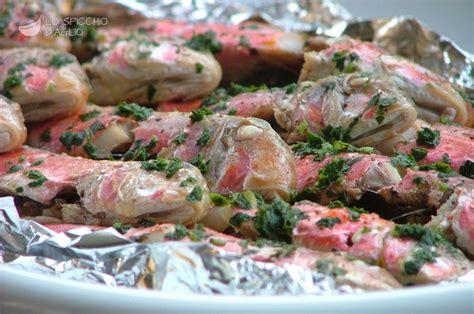 cucinare triglie al forno ricetta triglie al cartoccio le ricette dello spicchio