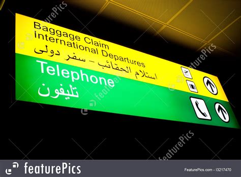 the at the baggage claim explaining the east west culture gap vintage contemporaries books airport terminal arabian baggage claim sign stock image