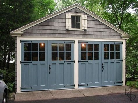 bldgproductoftheday carriage doors painted colonial blue they restore the historic character