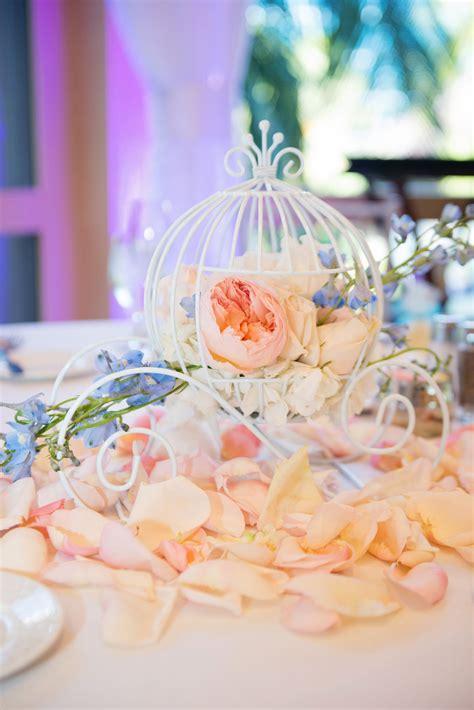 cinderella coach reception table decor at a disneyland wedding wedding table reception