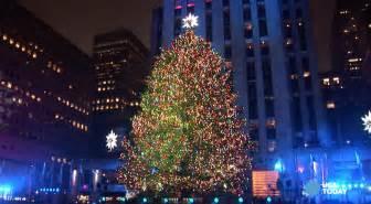 Rockefeller center christmas tree lights up new york