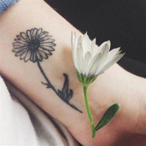 flower tattoo color small tattoo pinterest small wrist tattoo of a daisy on clara flower tattoos