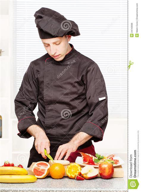 chef  black uniform cutting fruit royalty  stock images image