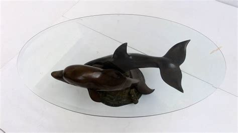 decorative casted bronze dolphins coffee table at 1stdibs