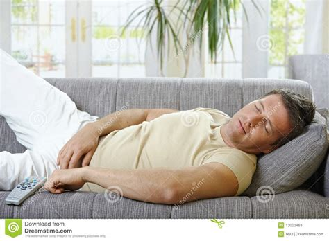 man sleeping on couch man sleeping on sofa stock photos image 13000463