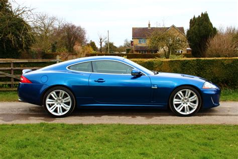 with blue 2009 09 plate jaguar xkr 5 0 coupe finished in metallic kyanite blue with charcoal