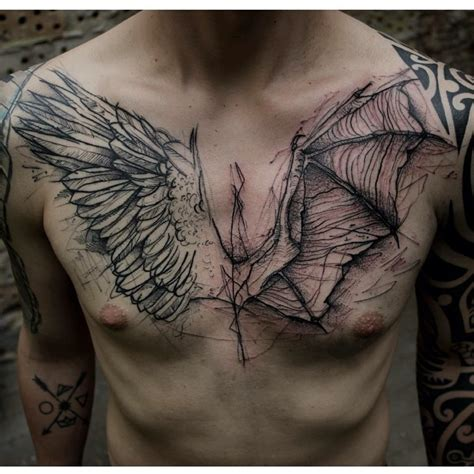 engraving style black ink chest tattoo of angel and demon