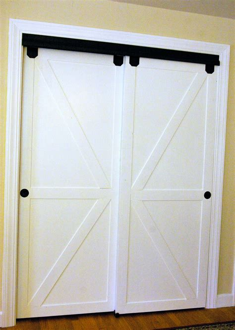 Diy Faux Barn Doors On A Sliding Bypass Closet Door 02 Bypass Barn Doors