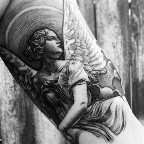 quarter sleeve angel tattoo 40 angel statue tattoo designs for men carved stone ink