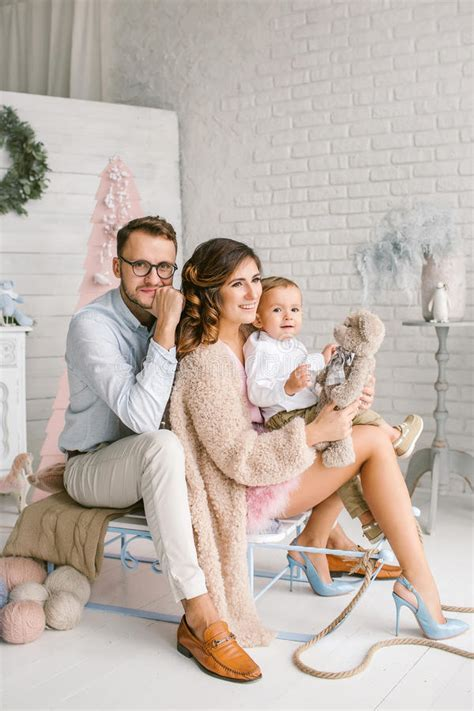 Decor Studio Photo by Happy Family With Baby In Decor Studio