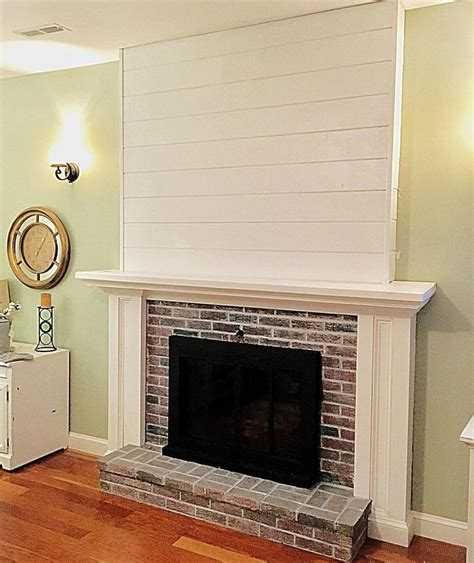 On Fireplace by Whitewashed Bricks Shiplap Brick Fireplace See This