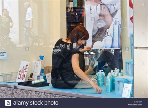 What Is A Window Dresser by Window Dresser With Hair Decorates Shop Window Of A Stock Photo Royalty Free Image