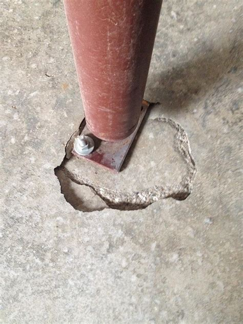 concrete   Is this cracking foundation under a jack post a