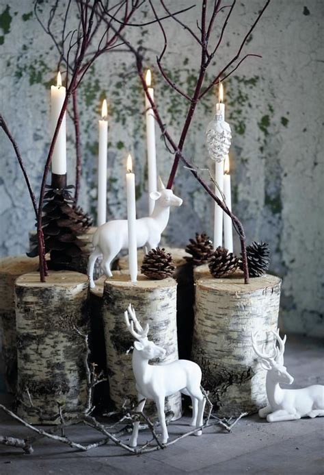white reindeer on birch logs with white candles