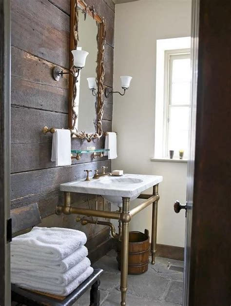 HAND TOWEL rack. Rustic bathroom boasts a plank accent