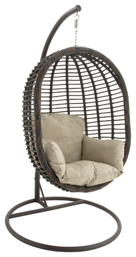 swinging pod chair metal and faux rattan pod chair with ivory cushion