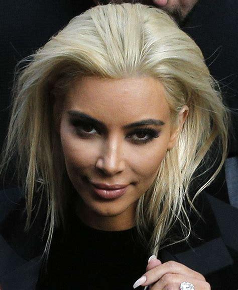 kim kardashian updates platinum hair color in paris kim kardashian unveils new blond hair color at paris