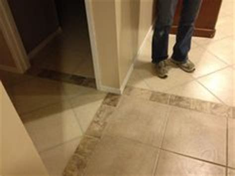 mosaic tile as transition   good way to use broken pieces