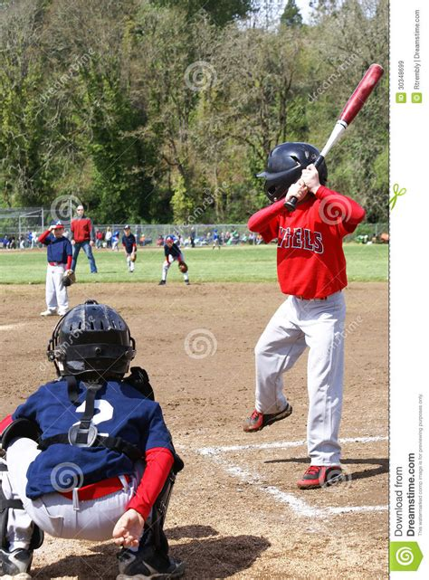 left handed baseball swing little league player up to bat editorial stock image