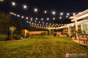 backyard lights backyard wedding reception uplights market lights