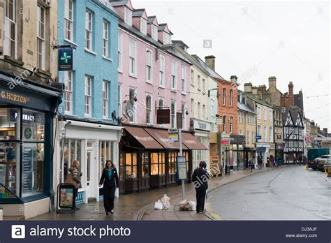high street british companies united kingdom uk buildings and shops in the high street at cirencester uk