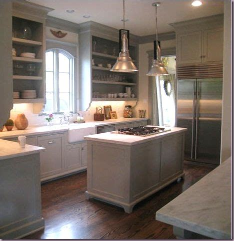 transitional kitchen with gray cabinets and farmhouse sink 1 shaw farm sink polished nickel bridge faucet 2