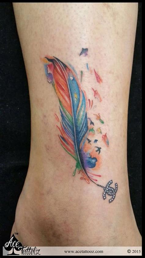 feather tattoo course colourful feather anklet tattoo with chanel logo ace tattooz