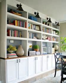 built in bookshelves with cabinet below i like the look of these built in shelves with cabinets