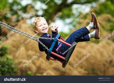 kid on swing little child on swing stock photo 151028330 shutterstock