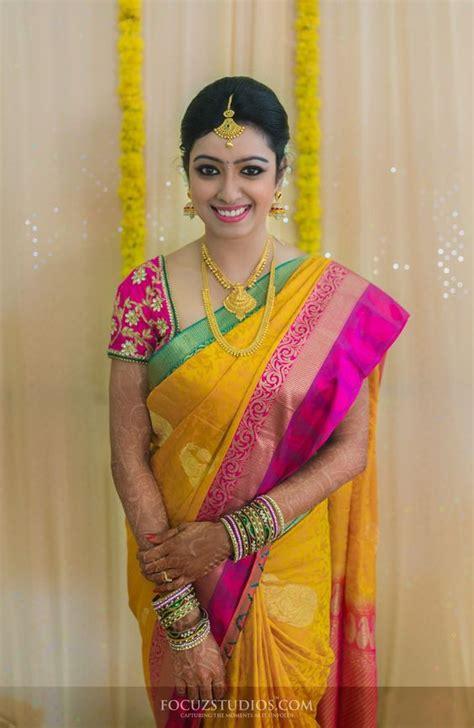 nisha krishnan yellow wedding silk saree pictures