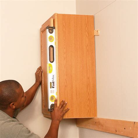how to hang wall cabinets how to install kitchen cabinets
