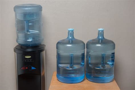 how to change a 5 gallon water cooler bottle with