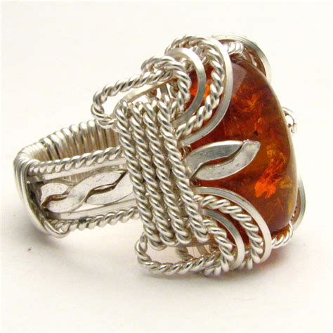 wire wrapped stirling silver ring by jandsgems on