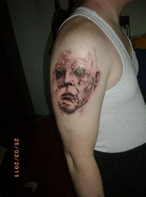 old ghost tattoo ghost on biceps tattooshunt