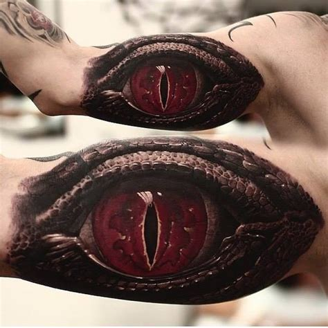 red eye tattoo realistic terrible eye reptile on arm by