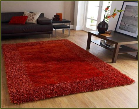 next carpets and rugs burnt orange rug next square grass or wool carpet interior furniture thick soft black sofa