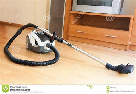 Vacuum Apartment At White Vacuum Cleaner On Parquet Stock Image Image 30621751