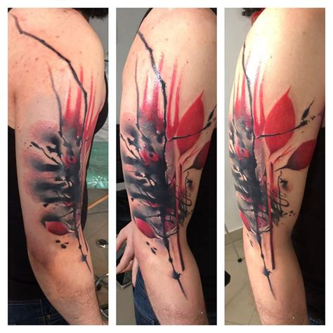 black and red tattoo style and black half sleeve by lukasz kaczmarek